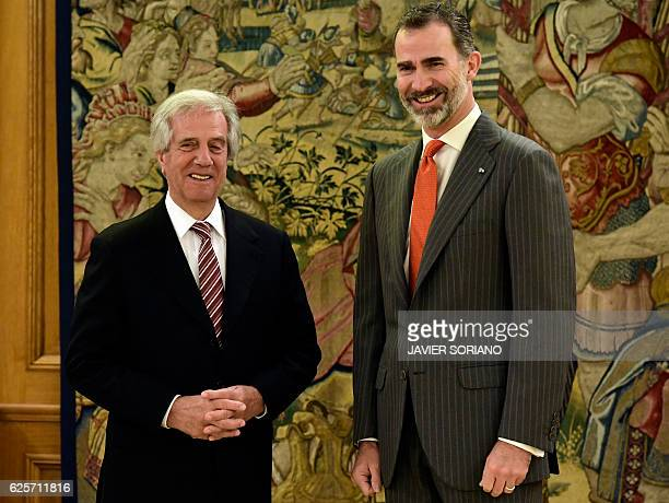 King of Spain Felipe VI and Uruguay's President Tabare Vazquez pose for photographers during their meeting at La Zarzuela palace in Madrid on...