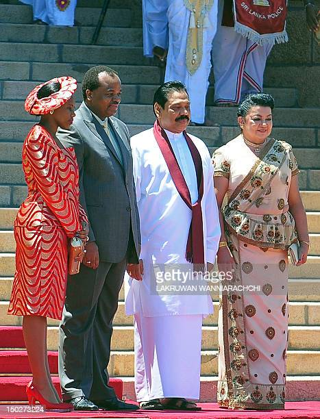 King of Swaiziland Mswati III and wife Inkhosikati Make Mahlangu poses for photographers with Sri Lankan President Mahinda Rajapaksa and Shiranthi...