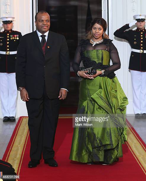 King of Swaziland Mswati III and spouse Inkhosikati La Mbikiza arrive at the North Portico of the White House for a State Dinner on the occasion of...