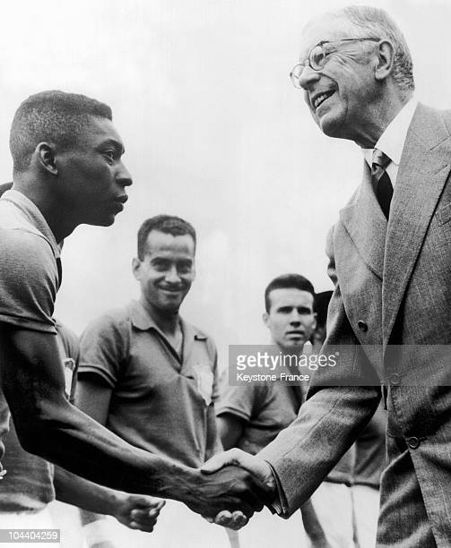 King of Sweden GUSTAV VI ADOLF is shaking hands with the Brazilian soccer player PELE before the final match of the World Cup against Sweden Brazil...