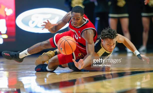 J King of the Louisville Cardinals and Carsen Edwards of the Purdue Boilermakers dive for the loose ball at Mackey Arena on November 28 2017 in West...