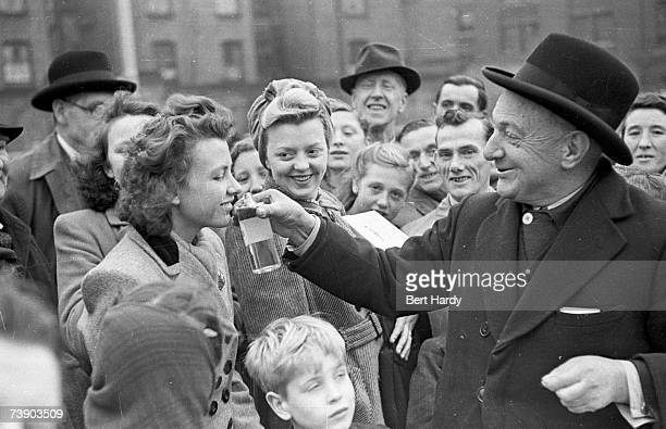 King of the Southwark street traders Jim Rumble selling compound at the Elephant and Castle in South London 8th January 1949 Original Publication...