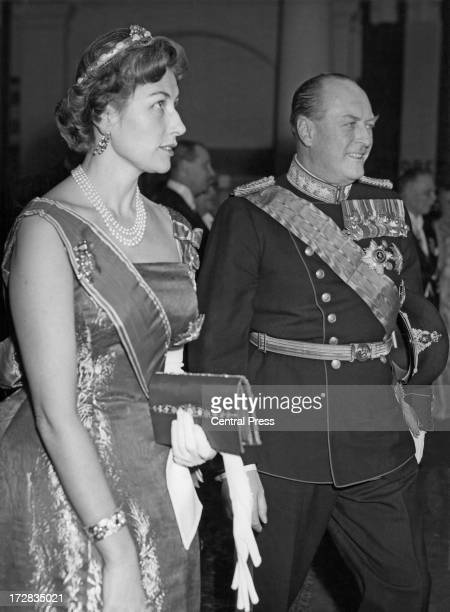 King Olav V of Norway and his daughter Princess Astrid of Norway attend a banquet given by the Belgian government at the Royal Palace of Brussels...