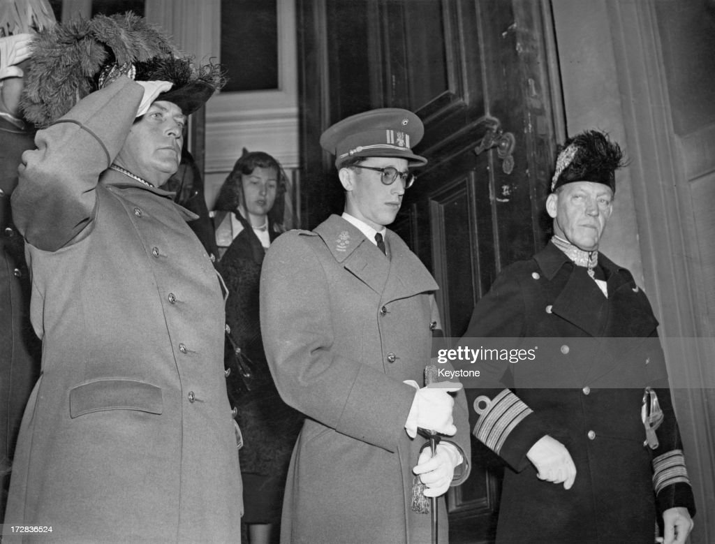 King Olav V of Norway (1903 - 1991) (left), King Baudouin of Belgium (1930 - 1993) (centre) and Prince Axel of Denmark (1888 - 1964) seen leaving the funeral service for Prince Carl of Sweden and Norway, Stockholm, 5th November 1951. Princess Astrid of Norway can also be seen behind the men.