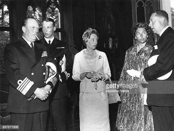 King Olav V the crown Prince Harald Princess Ragnhild and Princess Astrid at a reception at the American School in 1960 in Oslo Norway