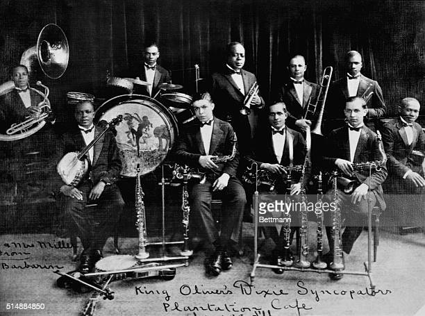 King Oliver was the cornet player and band leader who brought Louis Armstrong from New Orleans to Chicago helping to make jazz a more widespread...