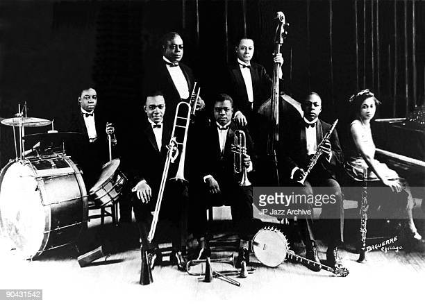 King Oliver's Creole Jazz Band pose for a studio group shot in the early 1920s, with Baby Dodds, Honore Dutrey, King Oliver, Louis Armstrong, Bill...