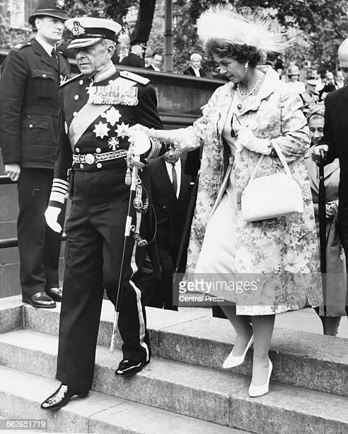 King Paul and Queen Frederika of Greece hand in hand as they arriving at Westminster Pier during a tour of London, July 10th 1963.