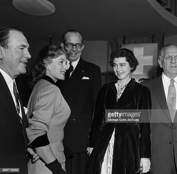 King Paul of Greece and Queen Frederica of Greece meet actor Pat O'Brien and Rhonda Fleming on a studio tour in Los Angeles,CA.