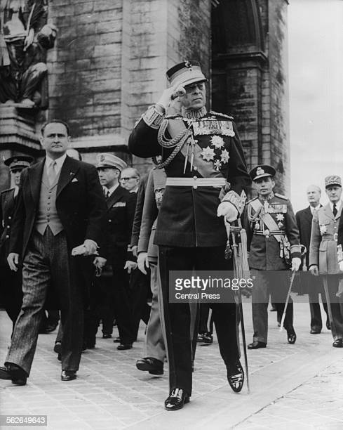 King Paul of Greece saluting as he arrives at the Tomb of the Unknown Soldier, on the left of him is the Minister for National Defense, Paris, June...