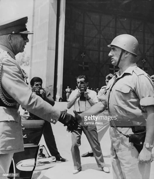 King Paul of Greece shaking hands with Colonel D Arpouzis of the Greek Regiment, after a flat ceremony in Cyprus, August 3rd 1960.