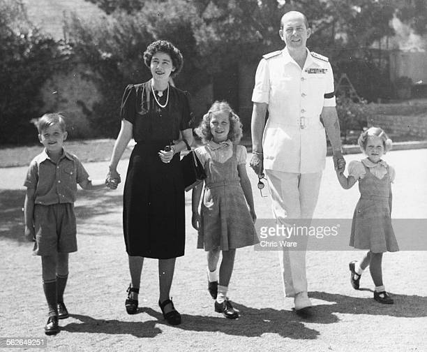 King Paul of Greece with his wife Frederika and children Prince Constantine and Princesses Sophia and Irene, in the grounds of the Royal Palace in...