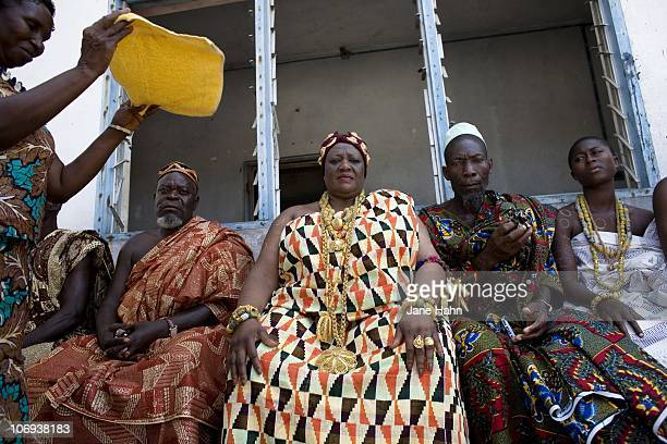 King Peggielene Peggy Bartels sits with the town elders at the site of her old palace in Otuam Ghana on October 3 2009 King Peggy dressed in royal...