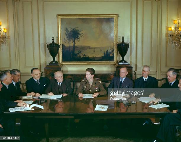 King Peter II of Yugoslavia pictured seated in centre at a conference table with members of his cabinet government in exile in London in May 1943...