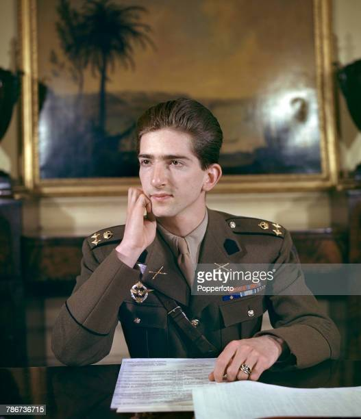 King Peter II of Yugoslavia pictured sitting at his desk in uniform during a period of exile in London in May 1943