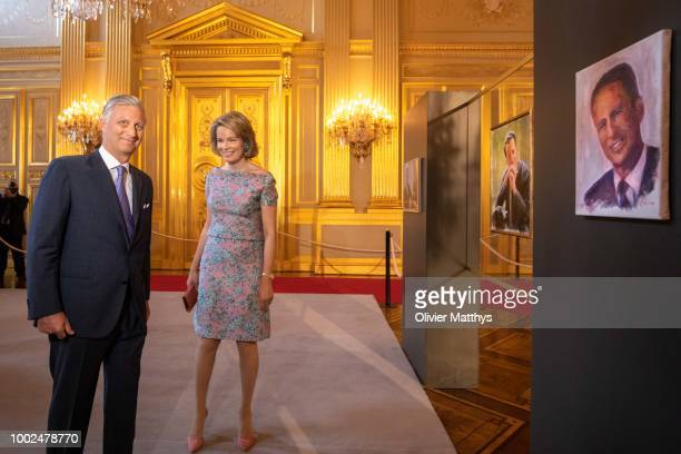Queen Mathilde of Belgium interacts with children as she walks through the inauguration of the Summer Exhibitions at the Royal Palace on July 20 2018...