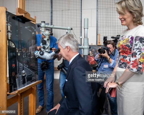 King Philip of Belgium and Queen Mathilde visit the restoration works of the paintings Mad Meg by Pieter Breughel de Elder and the Four Compositions...