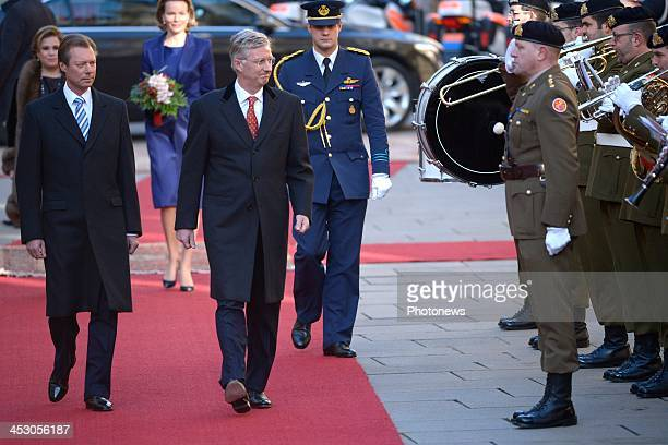 King Philippe and Queen Mathilde of Belgium attend a welcome ceremony hosted by Henri, Grand Duke of Luxembourg and Maria Teresa, Grand Duchess of...