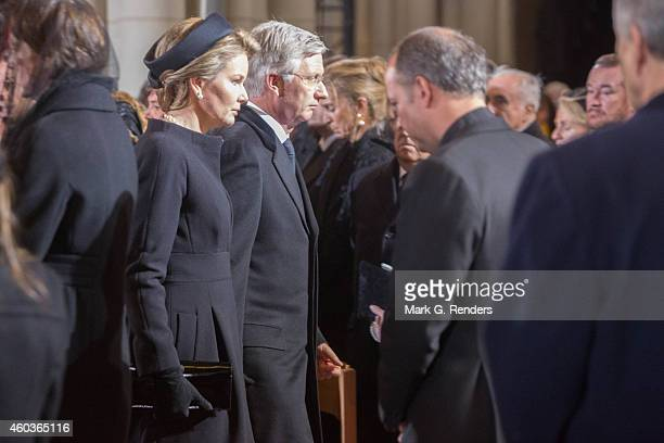 King Philippe and Queen Mathilde of Belgium attend the funeral of Queen Fabiola of Belgium at Notre Dame Church on December 12, 2014 in Laeken,...