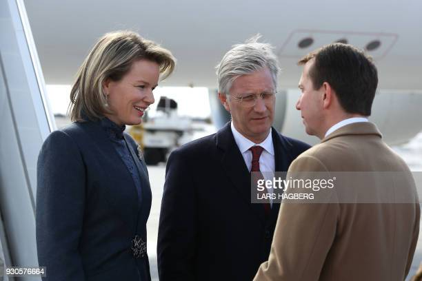 King Philippe and Queen Mathilde of Belgium speak with Scott Brison President of the Treasury Board after arriving at Ottawa International Airport in...
