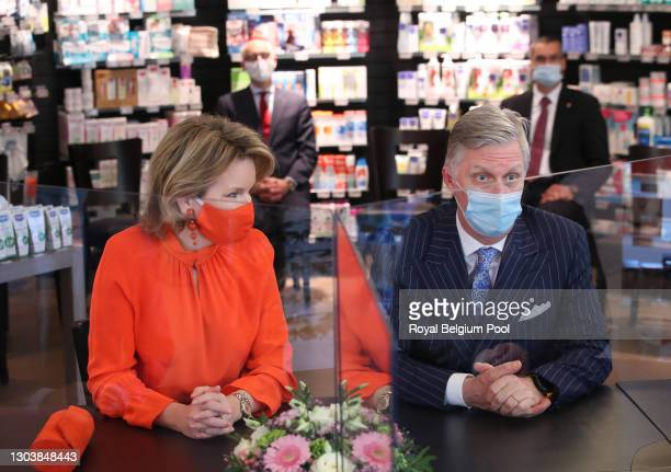 King Philippe and Queen Mathilde of Belgium visit the Pharma Haelvoet pharmacy on February 24, 2021 in Evere, Belgium. The Royal Couple participated...