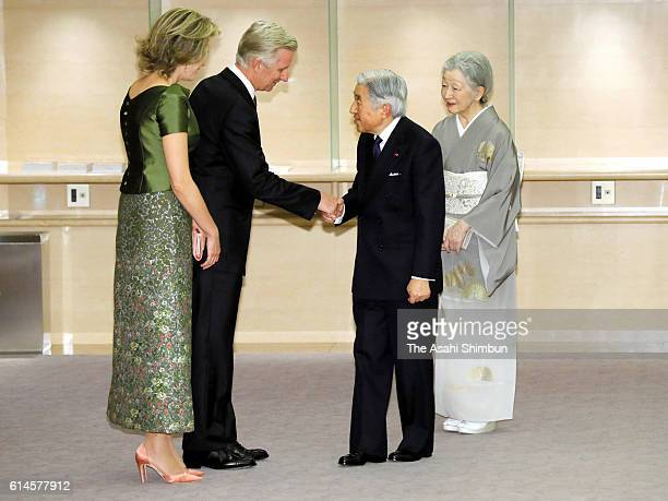 King Philippe and Queen Mathilde of belgium welcome Emperor Akihito and Empress Michiko on arrival at Kiyoicho Hall to attend a concert hosted by...