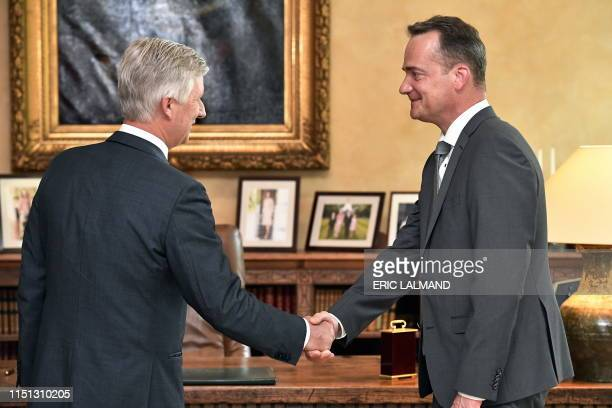 King Philippe - Filip of Belgium and German Community Minister President Oliver Paasch pictured during the oath ceremony of Paasch as...