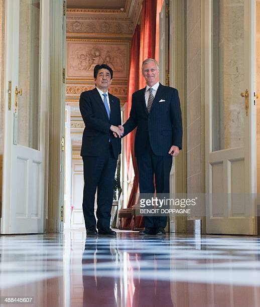 King Philippe Filip of Belgium and Japan Prime Minister Shinzo Abe pose for the photographers prior to a meeting between the Belgian Royals and Abe...