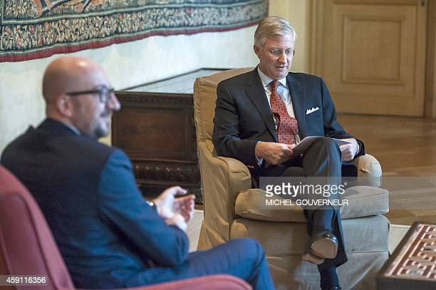 King Philippe Filip of Belgium attends a meeting with Belgian Prime Minister Charles Michel at the royal palace in Brussels on November 17 2014 POOL...
