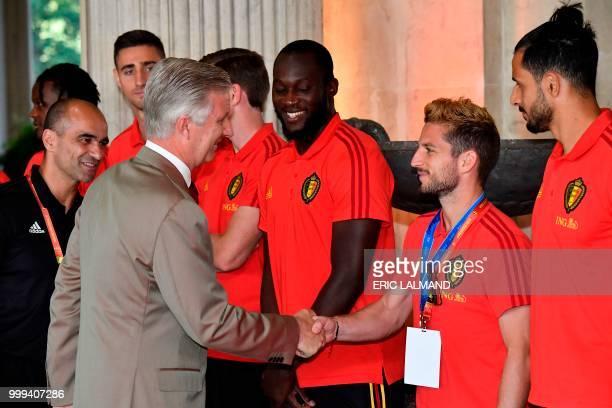 King Philippe Filip of Belgium congratulates Belgium's head coach Roberto Martinez and team players forward Romelu Lukaku forward Dries Mertens and...