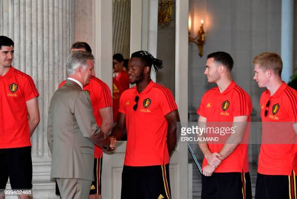 King Philippe Filip of Belgium congratulates Belgium's team players goalkeeper Thibaut Courtois forward Michy Batshuayi defender Thomas Vermaelen and...