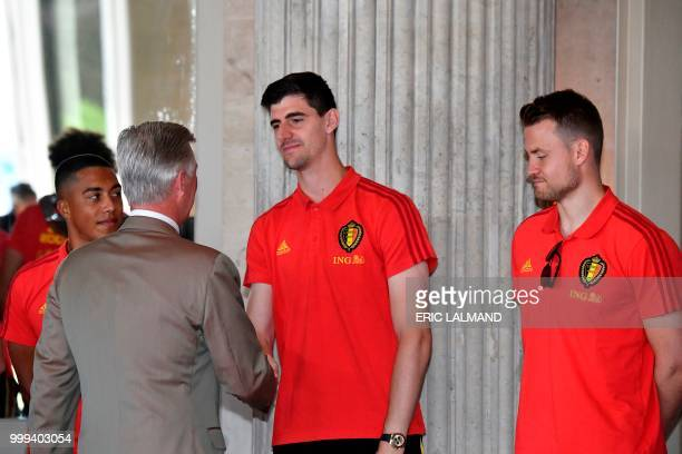 King Philippe Filip of Belgium congratulates Belgium's team players midfielder Youri Tielemans Belgium's goalkeeper Thibaut Courtois and goalkeeper...