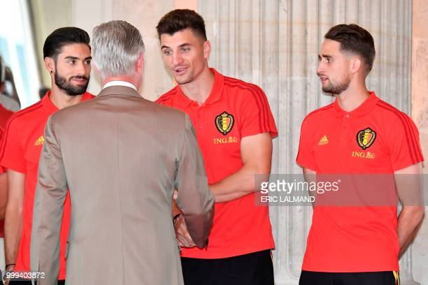 King Philippe Filip of Belgium congratulates Belgium's team players midfielder Yannick Carrasco midfielder Thomas Meunier and forward Adnan Januzaj...
