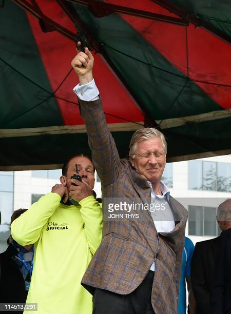 King Philippe - Filip of Belgium handles the starting pistol at the 40th edition of the Brussels' 20km run, Sunday 19 May 2019 in Brussels. BELGA...