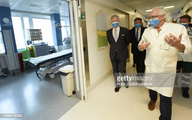King Philippe Filip of Belgium listens to UZ Brussel CEO Marc Noppen during a royal visit to several services at the UZ Brussel universitary hospital...
