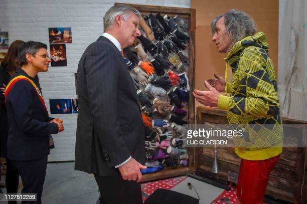 King Philippe - Filip of Belgium pictured during a visit of Belgian Royal couple in Antwerp province, with a social and artistic workshop called De...