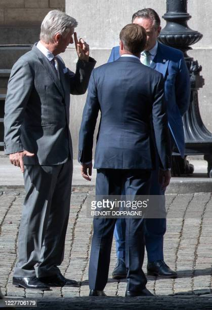 King Philippe - Filip of Belgium, PS chairman Paul Magnette and N-VA chairman Bart De Wever pictured after a meeting at the Royal Palace in Brussels,...