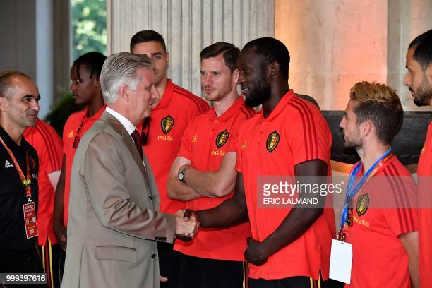King Philippe Filip of Belgium shakes hands with Belgian's forward Romelu Lukaku accompanied with Belgium's head coach Roberto Martinez and team...