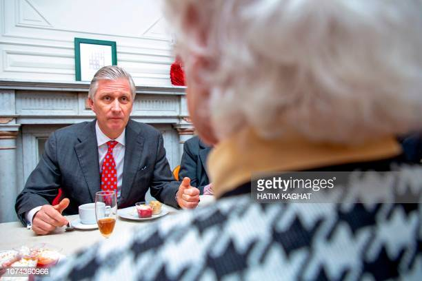 King Philippe Filip of Belgium sits during a christmas visit of Belgian Royal couple to the Biloba home a place of solidary life for old people of...
