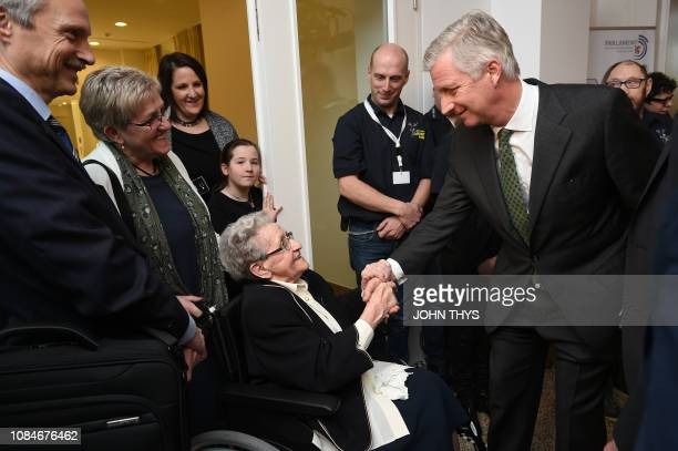 King Philippe Filip of Belgium talks to a hundred years old women during the celebrations for the 100th anniversary of the germanspeaking community...