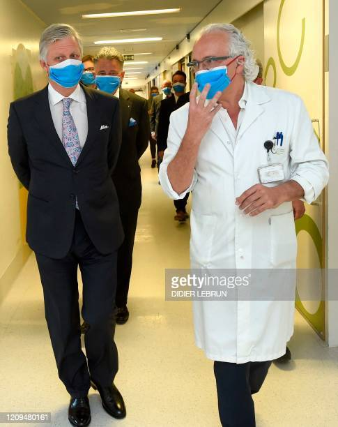 King Philippe Filip of Belgium talks to Marc Nopeen CEO of the Brussels University hospital as he visits the hospital in Jette Brussels during the...