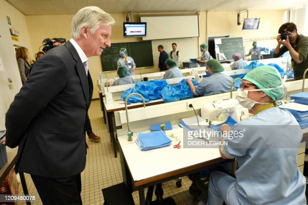 King Philippe Filip of Belgium talks to volunteers who are sewing face masks as he visits the UZ Brussel universitary hospital in Jette Brussels...