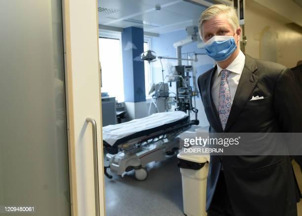 King Philippe Filip of Belgium wearing a face mask visits the UZ Brussel universitary hospital in Jette Brussels during the novel coronavirus...