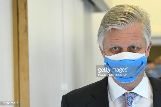King Philippe Filip of Belgium wearing a mask pictured during a royal visit to several services at the UZ Brussel universitary hospital in Jette...