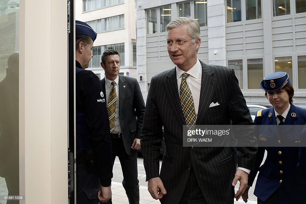 King Philippe of Belgium (2nd R) and Director of Belgian Federal Police Catherine De Bolle (R) arrive for a visit of the anti-terrorism cel of the Belgian federal judiciary police in Brussels, on March 16, 2016, following a shootout the day before during a major Belgian-French anti-terror operation in the city's Forest district. Police found an Islamic State flag next to the body of an Algerian killed during a major anti-terror raid in Brussels, prosecutors said on March 16, 2016, as investigators raced to track down two suspected extremists who escaped. Two suspects were still at large after the gunbattle, which erupted as Belgian and French police searched a property in connection with the November Paris massacre claimed by IS in which 130 people died. WAEM / Belgium OUT