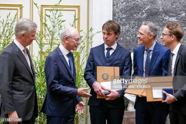 King Philippe of Belgium and former European Council President Herman van Rompuy award economists Laurens Cherchye , Bram De Rock and Frederic...