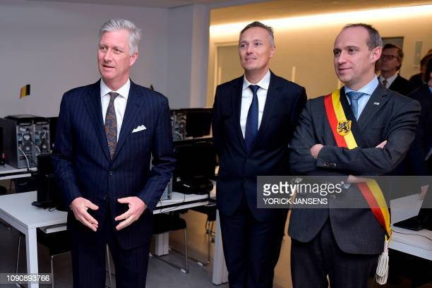 King Philippe of Belgium and Genk Mayor Wim Dries listens on during a visit to the T2 Technologie en Talent campus in Genk on January 29 2019 The T2...