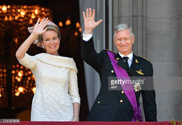 King Philippe of Belgium and his wife Queen Mathilde wave to the crowds from the balcony of the Royal Palace in Brussels on July 21, 2013. Prince...