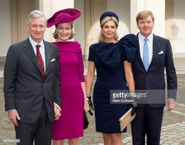 King Philippe of Belgium and Queen Mathilde of Belgium are met by King WillemAlexander of the Netherlands and Queen Maxima of the Netherlands during...