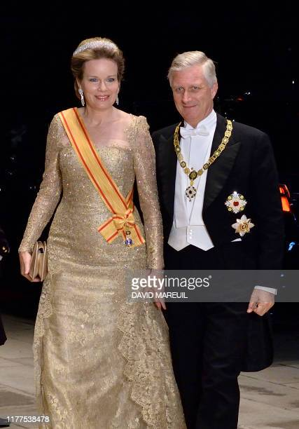 King Philippe of Belgium and Queen Mathilde of Belgium arrive at the Imperial Palace for the Court Banquets after the Ceremony of the Enthronement of...